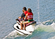 Family On Jet Ski Royalty Free Stock Photography