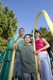 Family On Playground Smiling - Vertical Stock Image