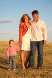 Family On The Meadow Royalty Free Stock Photography