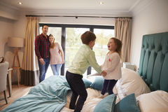 Free Family On Vacation With Children Playing On Hotel Bed Stock Photos - 78943673