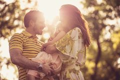 Family with one child enjoying outdoors. stock images