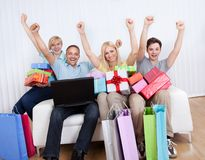 Family of online shoppers Stock Images