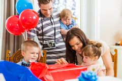 Family Opening Birthday Present At Home Royalty Free Stock Photography
