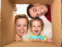 Family opening cardboard box Royalty Free Stock Photos