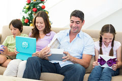 Family opening Christmas gifts Stock Photography