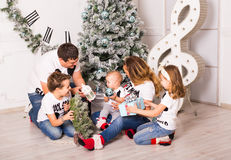 Family Opening Christmas Presents At Home Together Stock Photos