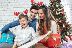Family opening colorful Christmas presents. With lots of fun stock photos