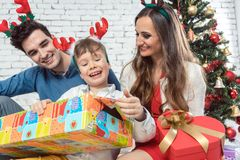 Family opening colorful Christmas presents royalty free stock photography
