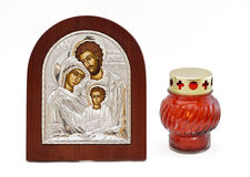 Family orthodox icon and candle Royalty Free Stock Photo