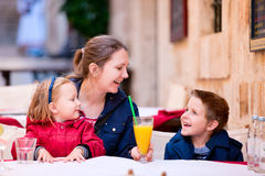 Family at outdoor cafe Royalty Free Stock Photos