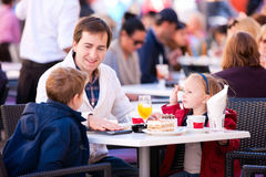Family at outdoor cafe Stock Images