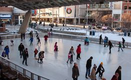 Family outdoor Ice skating. Families gather for fun and exercise at an outdoor skating venue in Silver Spring Maryland on a cold January day as temperatures Stock Photo