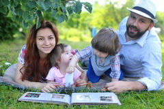 Family outdoor lay grass Royalty Free Stock Images