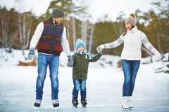 Family in outdoor rink Royalty Free Stock Photo