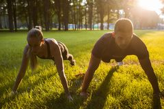 Family outdoor sport together workout background. Concept. pair training. sportsman spouses lifestyle Royalty Free Stock Photo