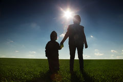 Family outdoor on sunset background Stock Image