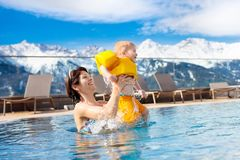 Family in outdoor swimming pool of alpine spa resort Royalty Free Stock Photography