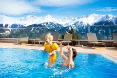 Family in outdoor swimming pool of alpine spa resort Stock Images