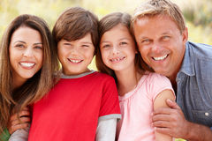 Family outdoors. Smiling at camera Royalty Free Stock Photography