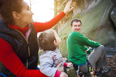 Family outdoors is climbing. Stock Photography