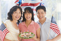Family outdoors on fourth of July with flags Royalty Free Stock Photo