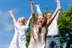Family outdoors jumping Royalty Free Stock Photo