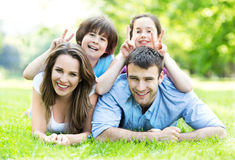 Family outdoors lying on grass Stock Image