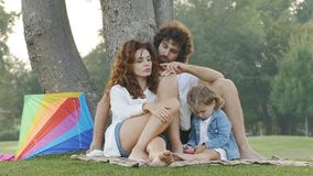 Family outdoors in the park. Slow motion video stock video
