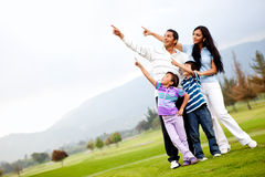 Family outdoors pointing Stock Photography