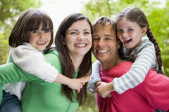 Family outdoors smiling Royalty Free Stock Photos