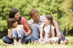 Family outdoors smiling Stock Photography