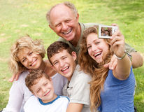 Family outdoors taking self portrait Royalty Free Stock Photos