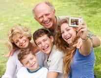 Family outdoors taking self portrait Royalty Free Stock Photos