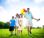 Family In Outdoors Walking Towards A Camera Royalty Free Stock Images