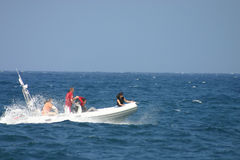 Family outing. Friends/family on a small speed boat in the sea round Malta, Mediteranean Stock Photos