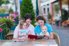 Family at an outside cafe Stock Images