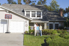 Family Outside There House Royalty Free Stock Photo