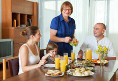 Family over healthy dining table Stock Images