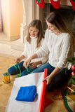 Family packing and decorating presents for Christmas Stock Images