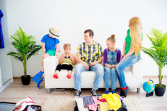 Family packing suitcases Royalty Free Stock Images