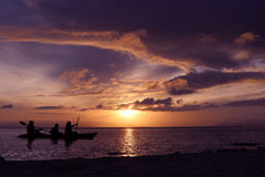 Family paddling a kayak by the sea. Royalty Free Stock Photo