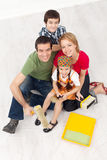 Family with paint preparing to redecorate their home Stock Images