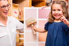 Family with paint sample card in store Stock Image