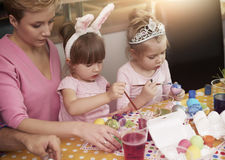Family painting Easter eggs Stock Image