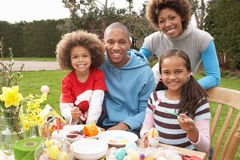 Family Painting Easter Eggs In Gardens Royalty Free Stock Photo