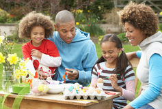 Family Painting Easter Eggs In Gardens Royalty Free Stock Photography