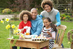 Family Painting Easter Eggs In Gardens Royalty Free Stock Photos