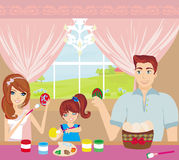 Family painting easter eggs Royalty Free Stock Image