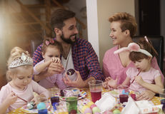Family painting Easter eggs Stock Photos