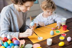 Family Painting Easter Eggs stock photo